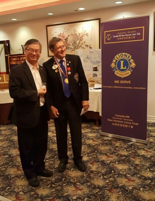 Most recent updates  Howard Wong receiving a 10-year Lions Award.
